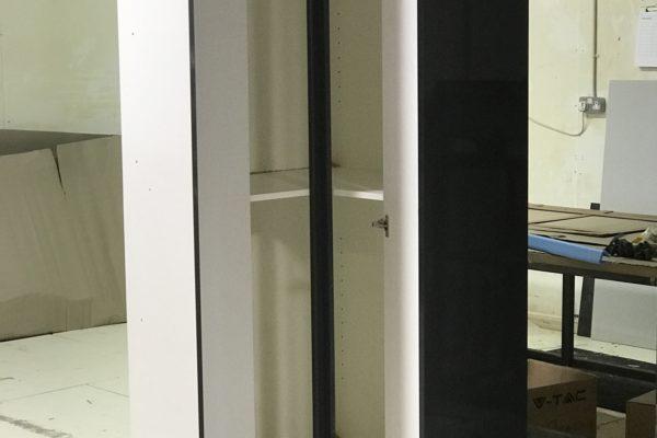 Tall bespoke corner cabinet
